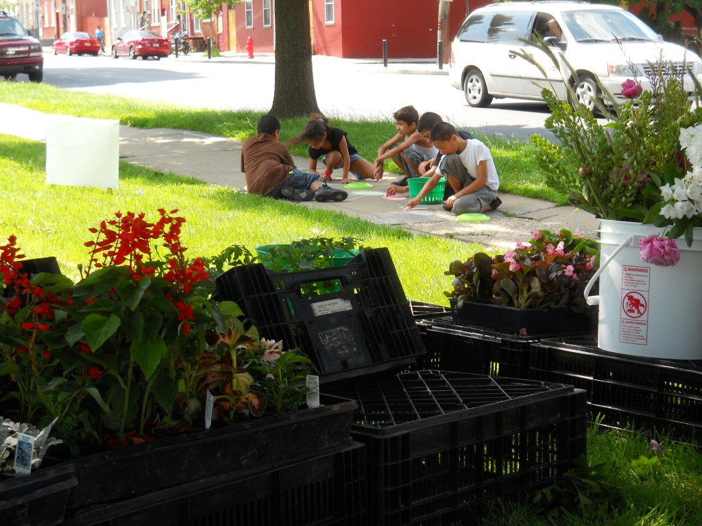 Our neighbors decorating the sidewalks with drawings of fruits and vegetables.